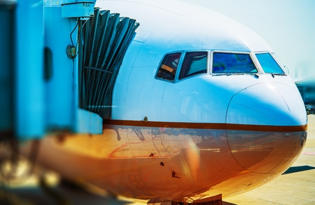 Airplane Flight. Docked Jet Airliner at the Airport. Air Transportation Concept. Stock Photo