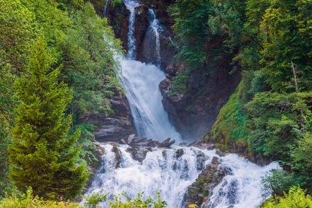 waterfall: Scenic Swiss Waterfalls. Switzerland Alps, Europe. Mountain Waterfall.