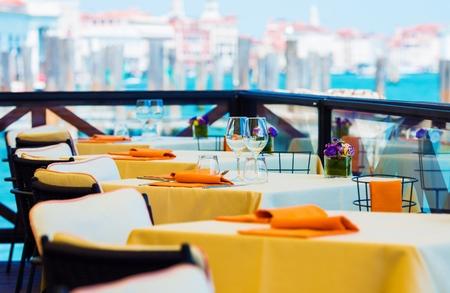 restaurant tables: Elegant Restaurant Dinning. Prepared Restaurant Tables Awaiting Customers.