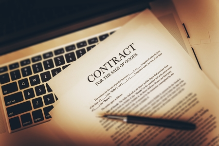 sign contract: Contract For The Sale of Goods Concept Photo. Contract on the Laptop Computer. Stock Photo