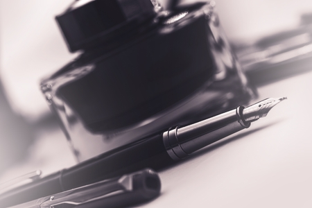 ink bottle: Fountain Pen and the Black Ink Bottle. Writing Concept.