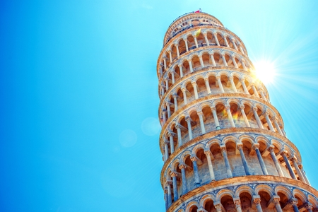 towers: Leaning Tower of Pisa, Italy, Europe. Tower of Pisa Over Blue Sky. Italian Architecture.