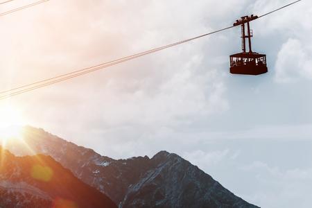 cable car: Mountains Gondola Lift at Sunset. European Alps Gondola Cable Car.