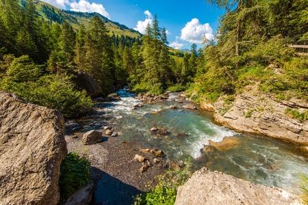 Alpine River in Switzerland. Swiss Alps Natural Landscape. Summer Scenery.