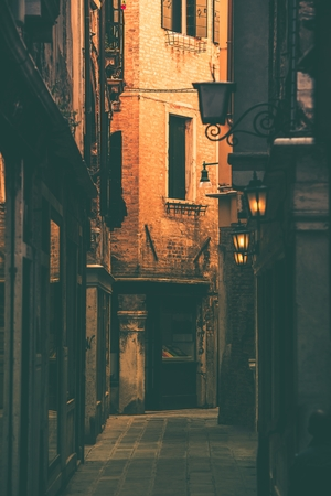history building: Venice Cozy Narrow Street. Venice, Italy. Italian Architecture. Stock Photo