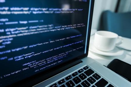 Website Coding. Website HTML Code on the Laptop Display Closeup Photo. Webdesigner Workstation. Archivio Fotografico