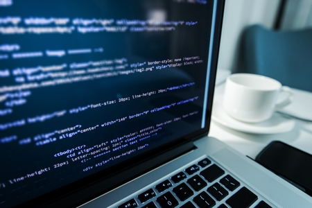 Website Coding. Website HTML Code on the Laptop Display Closeup Photo. Webdesigner Workstation. Standard-Bild