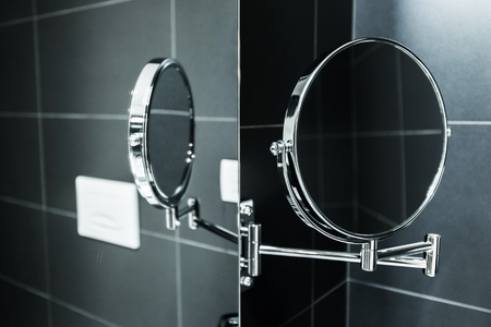 Elegant Stylish Magnifying Mirror Mirroring in Traditional Bath Mirror. Bathroom Accessories.