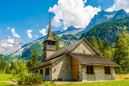 Kandersteg Mountain Chapel in Switzerland, Europe. Vintage Kandersteg Church and the Scenic Mountain View. Swiss Alps. Stock Photo - 44873028