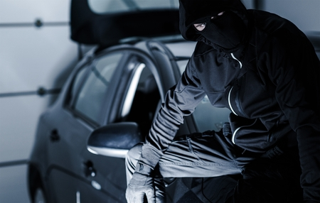 car theft: Satisfied Car Theft Seating on a Freshly Stolen Car. Stock Photo