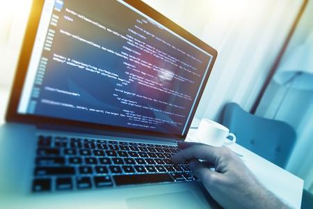 html: Modern Website Building Concept Photo. Working Web Programmer. Website HTML Code on a Display.