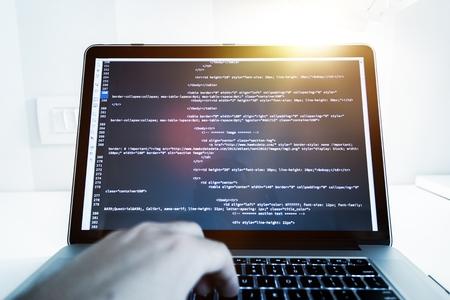 html: Website Programming Concept. Working Programmer Reviewing HTML Website Code. Internet Technologies. Stock Photo