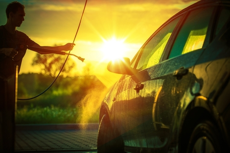 soaping: Spring Car Washing During Sunset. High Pressure Water Washing System. Stock Photo