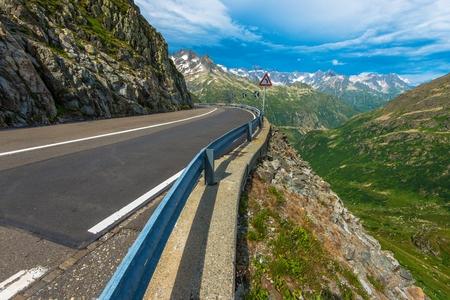 Winding Swiss Alpine Road. Swiss Alps Mountain Road. Switzerland, Europe. Stock Photo