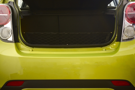 trunk: Compact Car Trunk Closeup Photo. Green Body Compact Vehicle.