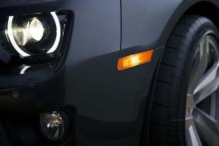 alloy wheel: Modern Car Closeup Photo. Headlight and Alloy Wheel Closeup. Modern Transportation.