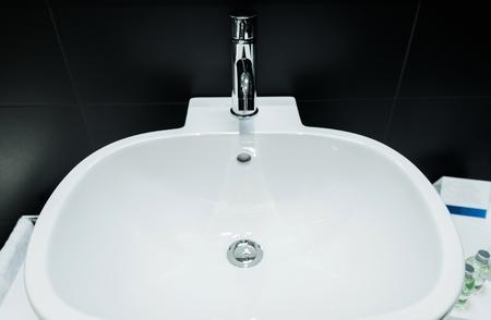 bathroom tiles: Modern Bathroom Bowl Sinks and Black Tiles Bathroom Interior Design.