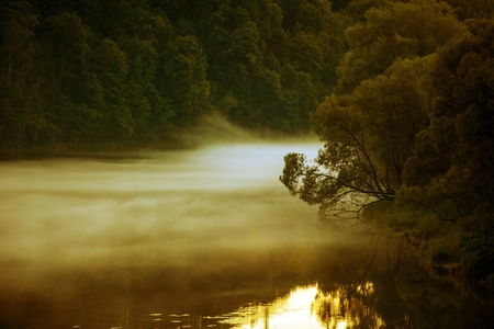 fog: Foggy River at Dusk. Summer River Fog. Stock Photo