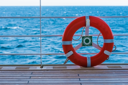 life saving: Lifebuoy Lifering on a Deck of Cruise Ship. Life Saving Ring Known Also As Lifesaver or Preserver or a Lifebelt. Stock Photo