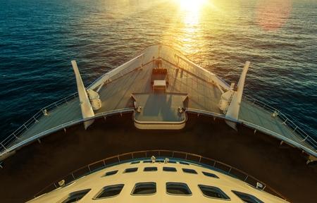 liner transportation: Cruise Ship Ocean Crossing. Sunset Scenery. Large Cruise Vessel. Ocean Liner. Marine Transportation. Stock Photo