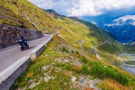 pass on: Mountain Road Biking. Motorcycle on Italian Stelvio Pass Alpine Road.