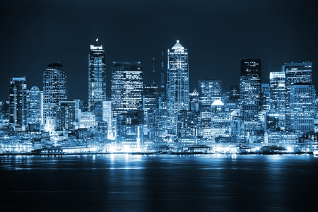 city skyline: Night in the Seattle. Seattle, Washington City Skyline. Vivid Blue Color Grading. United States.