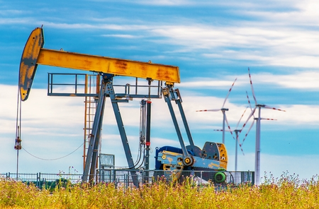 fossil fuels: Oil Pump and Wind Turbines. Renewable Wind Energy and Fossil Fuels Energy. Stock Photo