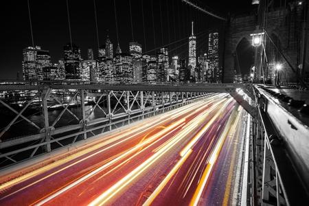 speeding: Brooklyn Bridge New York Traffic Light. Manhattan and Brooklyn Bridge at Night. United States of America.