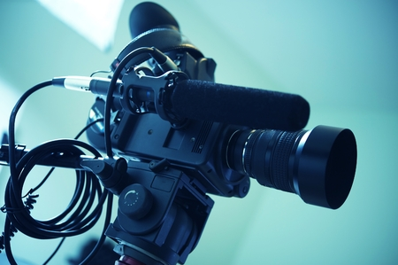 Interview Video Camera Setup. Modern Video Camera or Camcorder with Shotgun Microphone.