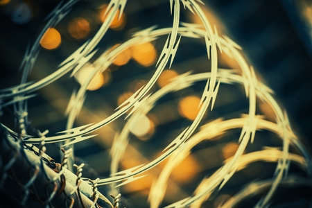 wire fence: Barbed Wire Fence Closeup. Jail Wire Fence. Stock Photo