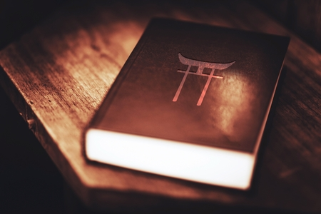 Ethnic Religion of the People of Japan. Shinto Ancient Religion Book Closeup.