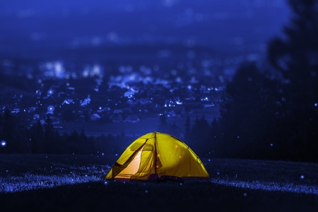 tent city: Campsite Near City. Small Tent Camping with City View. Outdoor Recreation Theme. Stock Photo
