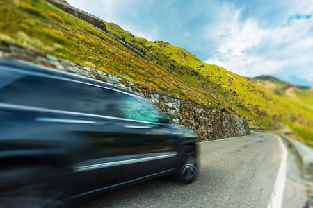 sport utility vehicle: Mountain Road Fast Driving. Modern Sport Utility Vehicle on the Italian Stelvio Pass.
