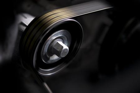 alternator: Vehicle Alternator in Motion Closeup Photo. Car Engine Elements. Stock Photo
