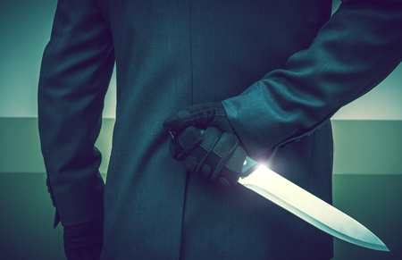 Elegant Suit Wearing Psychopathic Murderer with Huge Knife Ready To Attack. Conceptual Crime Photo.