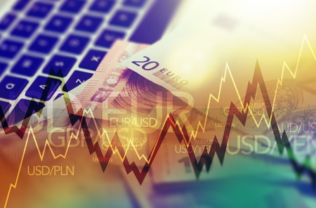 currencies: Trading Markets. Forex Currency Trading Concept with Computer, Cash Euro Money and Some Line Graph Statistics. Stock Photo