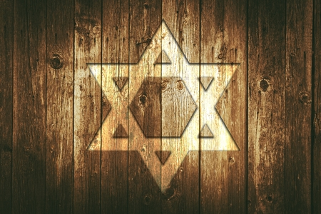 David Star on a Wood Wall. Aged Wooden Barn Wall with David Star Symbol on it. Reklamní fotografie - 50695632