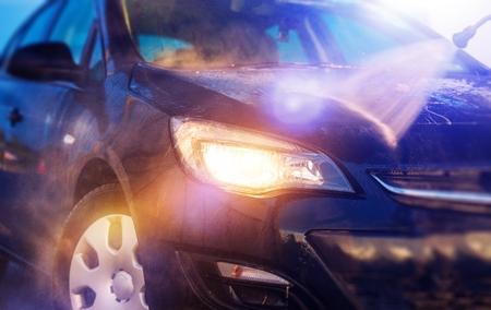 High Pressure Water Car Washing Closeup. Car Washing.