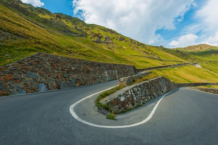 pass on: Winding Alpine Road in Italian Alps. Famous Stelvio Pass Road in a Summer Time. Italy, Europe.