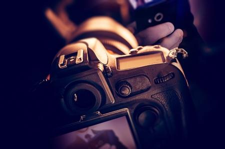 photo pictures: Taking Digital Pictures Using Professional DSLR Digital Camera Equipment. Closeup Photo Concept.
