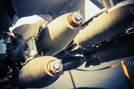 aerial bomb: Bombs Under the Wing. Fighter Jet Ready for Bombing Mission. Military Technology.