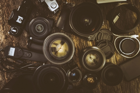 Photographer Equipment. Digital and Analog Photography Lenses and Cameras.