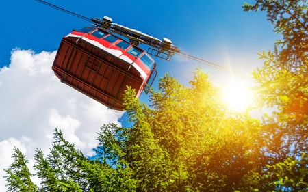 car lift: Cable Car Lift Summit Ride in a Sunny Summer Day. Visiting Mountains Location.