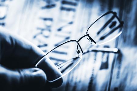 Reading Glasses. Visual Correction Concept Photo. Mono Blue Color Grading. 免版税图像