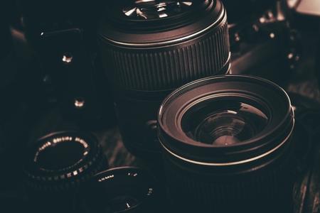 Photo Lenses Kit. Professional Photography Lenses Closeup. Dark Brown Color Grading. Stock Photo
