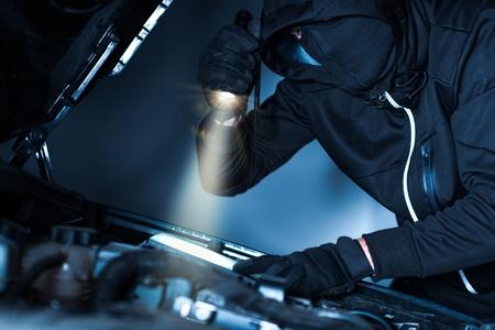 Car Thief with Flashlight.
