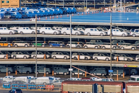 stock: New Cars Cargo Delivery. Brand New Cars Awaiting Custom Clearance. Stock Photo