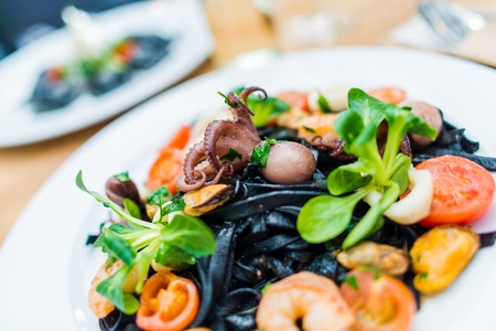 Seafood Black Pasta Spaghetti with Squid and Other Fruit of the Sea. Spaghetti Ai Frutti Di Mare. Italian Food Specials.