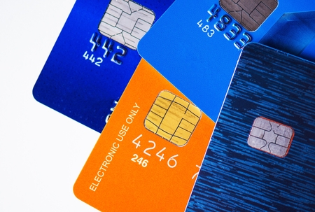 micro chip: Four Premium Credit Cards with Microchip Closeup Photo.