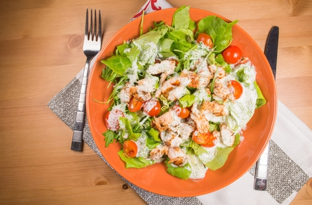 chicken caesar salad: Freshly Made  Chicken Caesar Salad Garlic Sauce on Wooden Table. Stock Photo